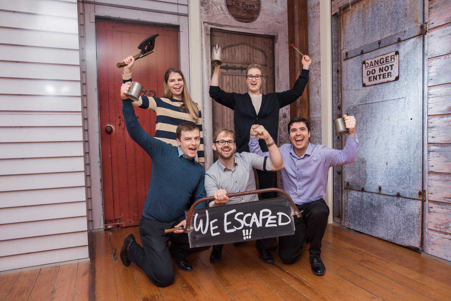 Team celebrating escaping the escape room